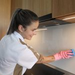 Crown Maids - Cleaning Kitchen Wall